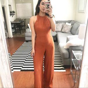 Open back orange jumpsuit